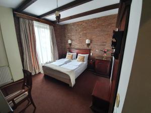 A bed or beds in a room at Atrium Boutique Hotel Cluj City Center