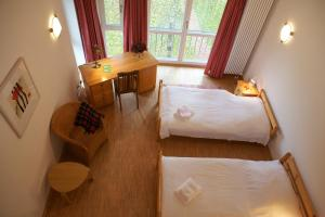 Ein Bett oder Betten in einem Zimmer der Unterkunft ABC Bildungs- und Tagungszentrum e.V.