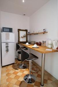 A kitchen or kitchenette at Le 3 Rue Grande
