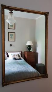 A bed or beds in a room at APARTAMENT SPA NENUFARY - Enklawa Puszcza Białowieska