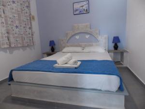 Un ou plusieurs lits dans un hébergement de l'établissement Porto Apergis