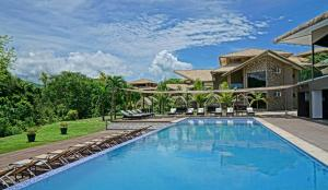 The swimming pool at or near Nammbú Beach Front Bungalows