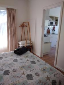 A bed or beds in a room at Blue Waters Holiday Cottages