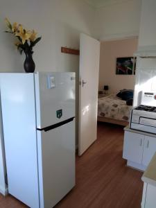 A kitchen or kitchenette at Blue Waters Holiday Cottages