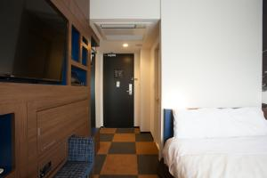 A bed or beds in a room at Henn na Hotel Tokyo Haneda