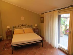 Кровать или кровати в номере Agriturismo La Possioncella