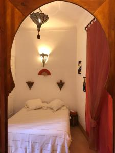 A bed or beds in a room at Riad Irene