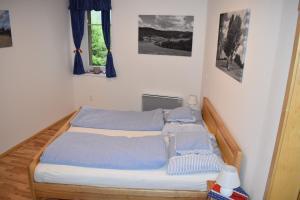 Postel nebo postele na pokoji v ubytování Apartman Razula