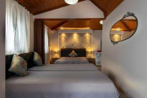 Ένα ή περισσότερα κρεβάτια σε δωμάτιο στο Magda Rooms ''Sea View''