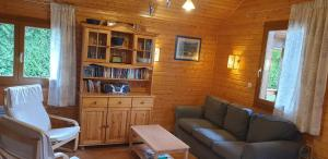 A seating area at Chalets les Silènes