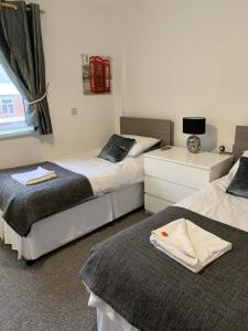 A bed or beds in a room at Sandford Promenade