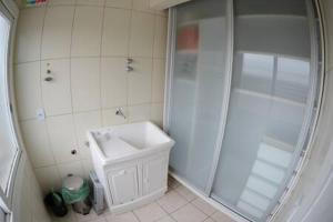 A bathroom at Apartamento aconchegante e confortável