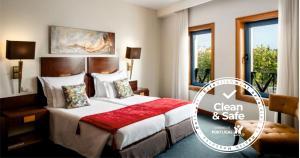 Un ou plusieurs lits dans un hébergement de l'établissement Hotel Moliceiro
