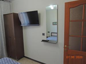 Телевизор и/или развлекательный центр в Guest House Bereza