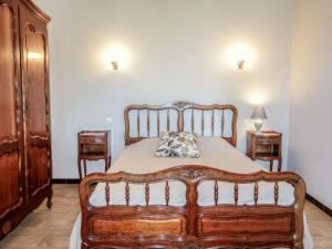 A bed or beds in a room at Villa Les Dahlias