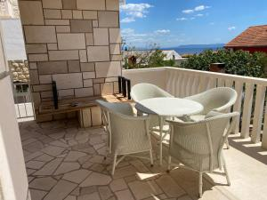 Balkón nebo terasa v ubytování Villa Mediterra Garden & Pool