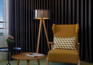 Ein Sitzbereich in der Unterkunft Madeira Panorâmico Hotel