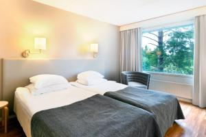 Un ou plusieurs lits dans un hébergement de l'établissement Break Sokos Hotel Eden