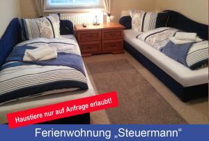Ein Bett oder Betten in einem Zimmer der Unterkunft Villa Lotsenberg