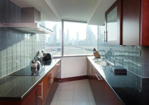 A kitchen or kitchenette at Jumeirah Living World Trade Centre Residence, Suites and Hotel Apartments