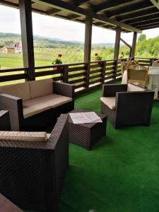 A seating area at Popasul Ioana Oncesti