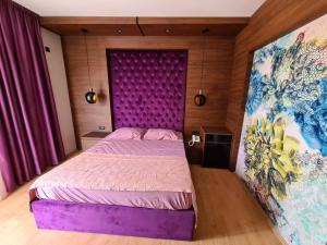 A bed or beds in a room at Hotel Zeleni Vir