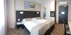 Postel nebo postele na pokoji v ubytování Wellness Hotel Step