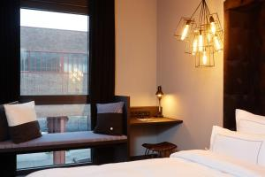 A bed or beds in a room at hotel friends Essen Zeche Zollverein