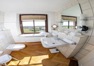 Ein Badezimmer in der Unterkunft Hotel Restaurant Zum Burggraf