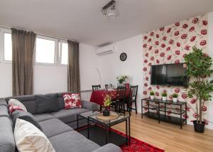 Posezení v ubytování Bloom Apartment