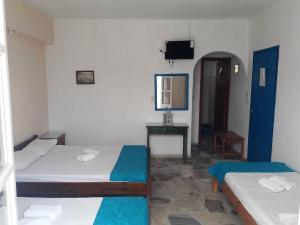Łóżko lub łóżka w pokoju w obiekcie Hotel Rea