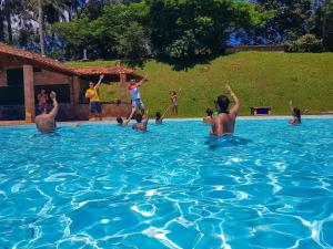 The swimming pool at or near Hotel Rio de Pedras