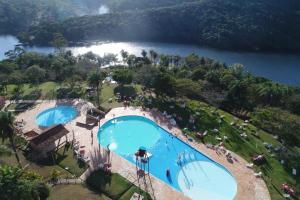 A view of the pool at Hotel Rio de Pedras or nearby