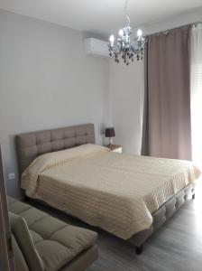 A bed or beds in a room at HILI RESORT LUXURIOUS SEASIDE APARTMENT