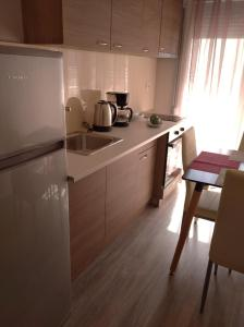 A kitchen or kitchenette at HILI RESORT LUXURIOUS SEASIDE APARTMENT
