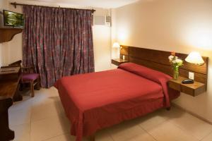 Lova arba lovos apgyvendinimo įstaigoje Hotel Carollo