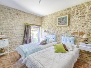 A bed or beds in a room at Lovely Farmhouse in Talon with Fireplace