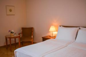 A bed or beds in a room at Vila Bled