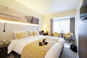Кровать или кровати в номере Mercure Oostende