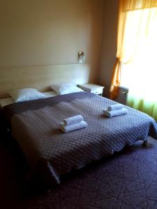 A bed or beds in a room at Alba Hotel