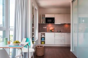 A kitchen or kitchenette at Mintrops Concierge Hotel