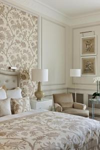 En eller flere senger på et rom på Beau-Rivage Palace