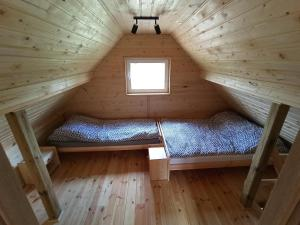 Łóżko lub łóżka w pokoju w obiekcie Agroturystyka Sominy Piotr