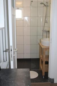 Een badkamer bij Woonhotel Petruskerk