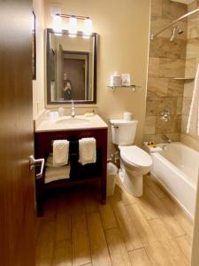 A bathroom at Best Western Plus Waterbury - Stowe
