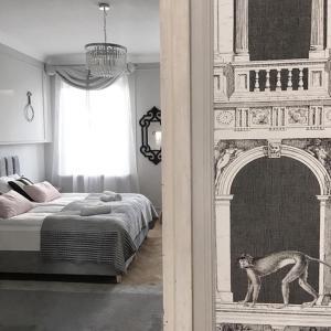 Postel nebo postele na pokoji v ubytování Exclusive Art Deco Boutique