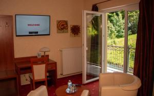 TV/Unterhaltungsangebot in der Unterkunft Hotel Laux