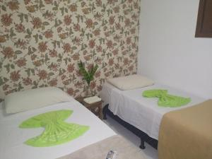 A bed or beds in a room at POUSADA SUCEGATE'S - Joinville
