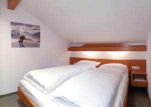 Ein Bett oder Betten in einem Zimmer der Unterkunft Das Bergfried - Urlaub zentral und ruhig!
