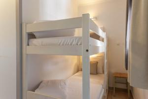 A bunk bed or bunk beds in a room at Village Pierre & Vacances Pont Royal en Provence